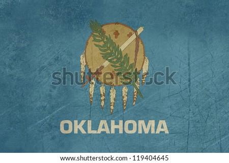 Grunge Oklahoma state flag of America, isolated on white background. - stock photo