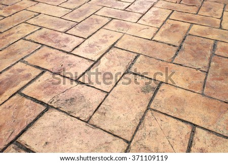 Grunge Old Cracked Brown Brick Stone Street Road. Sidewalk, Pavement Texture Background - stock photo