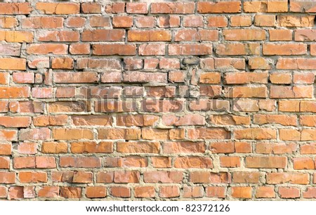 Grunge orange brick wall background texture - stock photo