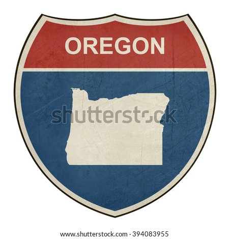 Grunge Oregon American interstate highway road shield isolated on a white background. - stock photo