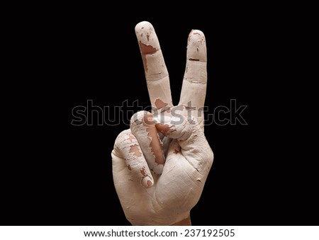grunge painted hand making the V sign isolated over black background - stock photo