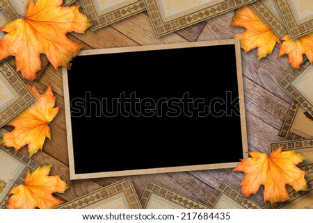 Grunge paper design in scrapbooking style with photoframe and autumn foliage - stock photo
