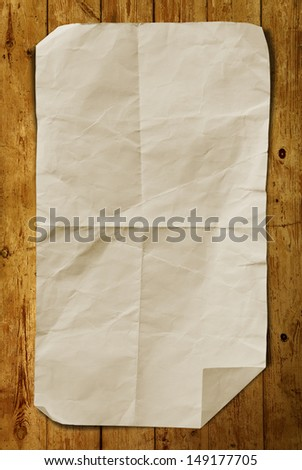 Grunge Paper on wood background