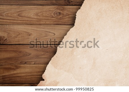 grunge paper on wooden wall. - stock photo