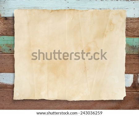 Grunge paper texture on vintage wooden background. - stock photo