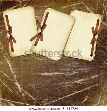 Grunge papers with bow on dark background
