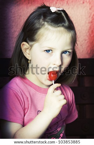 Grunge photo of a girl with lollipop - stock photo