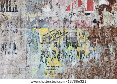 grunge ripped poster background - texture of torn advertisement on an old rusty billboard panel  - stock photo