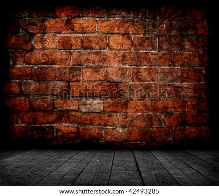Grunge room interior with red brick wall - stock photo