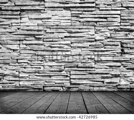 Grunge room interior with stone wall - stock photo