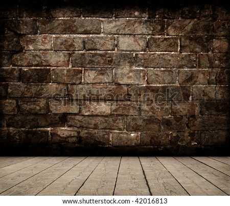 Grunge room with brick wall - stock photo