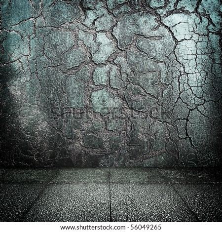Grunge room with distressed walls - stock photo