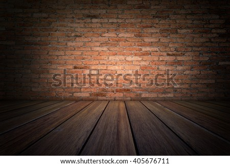 Grunge room with wooden floor and red brick wall background - stock photo