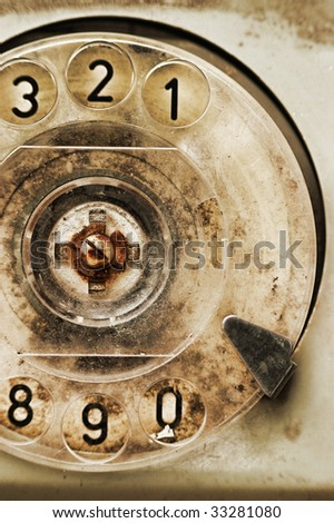 Grunge: rotary dial of old broken phone