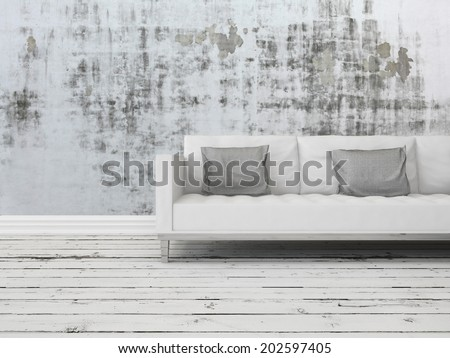 Grunge rustic greyscale interior decor background with a white sofa against a patterned abstract wall with old worn wooden white painted floor boards - stock photo