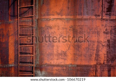 Grunge rusty metal background with a ladder