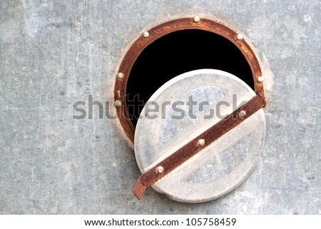 Grunge rusty metal tank sheet with lid and rivets - stock photo