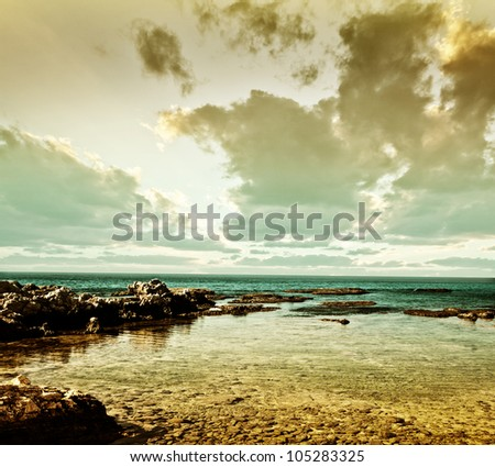 Grunge sea landscape, beautiful peaceful seaview, calm ocean water, summer beach, nature background, old postcard with cloudy sunset - stock photo