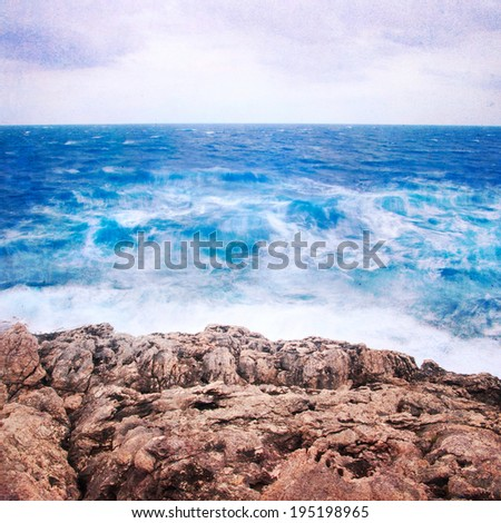 Grunge seascape with danger waves. Neutral densitiy filter used to make blurry waves. - stock photo