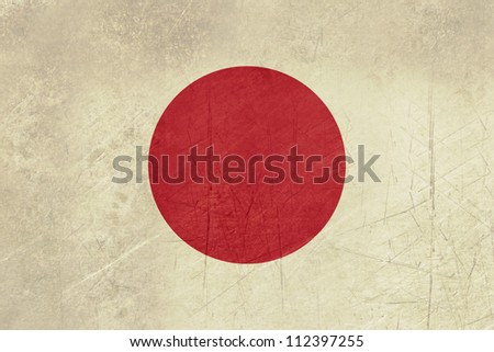 Grunge sovereign state flag of country of Japan in official colors.