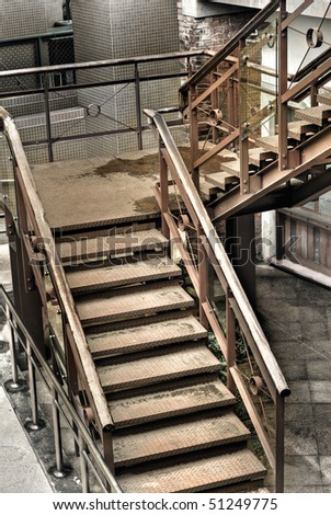 Grunge stair in old and dirty building of factory.