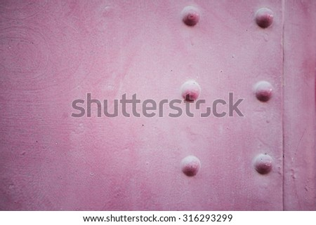 Grunge steam punk background metal plate with screws. Metal old pink steam punk background.  - stock photo