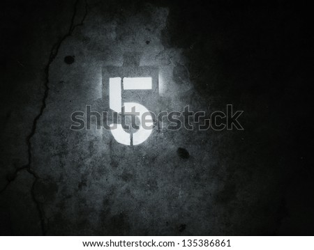 Grunge stencil number five on concrete background - stock photo