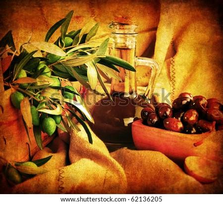 Grunge still life, old styled image of olives & olive oil - stock photo