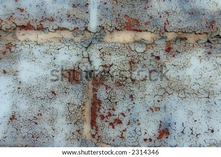 Grunge Style background of flaking paint on bricks