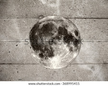 Grunge style collage of full moon (seen with my own telescope, no NASA images used) and a concrete wall - stock photo