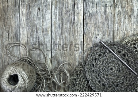 Grunge style decoration with old handmade doilies, jute cord and crochet hook over wooden background. Sweet composition for your design.  - stock photo