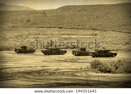 Grunge style image of modern armored tanks in battle - stock photo