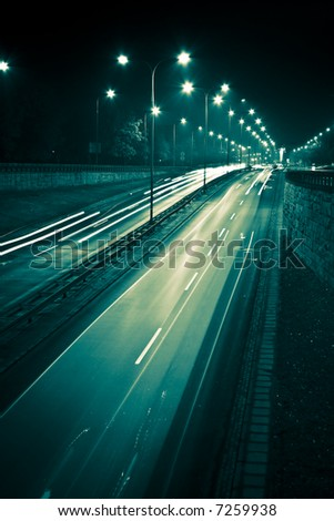 Grunge style night city highway with car lights - stock photo