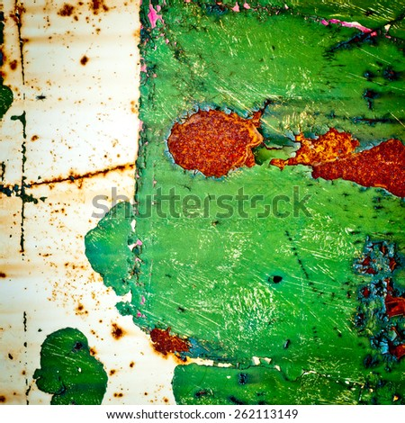Grunge texture background. Rusty metal with cracked green paint surface. Abstract painting. - stock photo