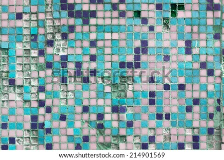 Grunge texture of broken tiles on old wall