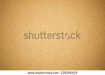 Grunge textured recycled paper with natural fiber parts with vignetting - stock photo