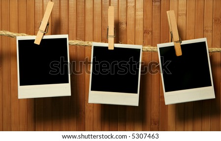 Grunge Vintage instant photo Frames on Bamboo Background With Intense Shadows - stock photo