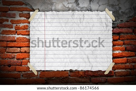 Grunge vintage old white paper on brickwall background - stock photo