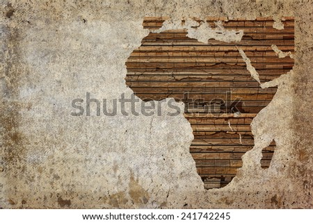 Grunge vintage wooden plank Africa map background. - stock photo