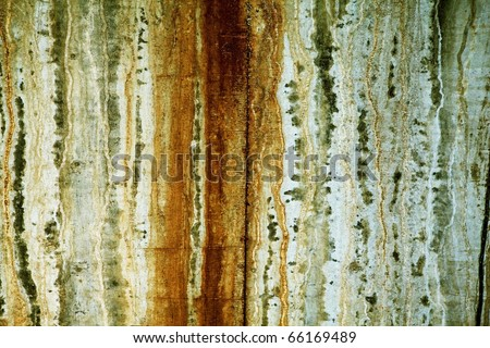 Grunge wall texture with rust and water streak marks and cracks. High resolution.