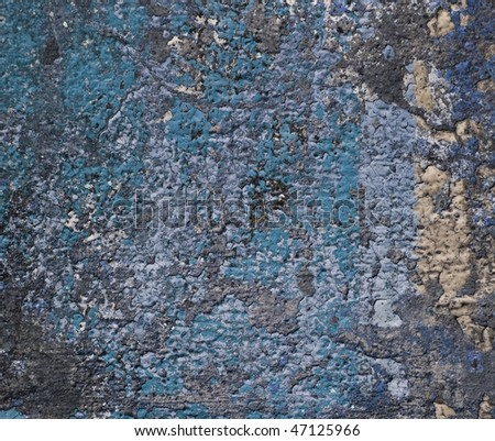 Grunge wall with blue paint residue