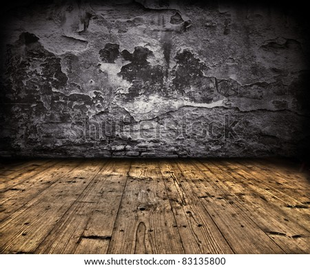 Grunge wall with wooden planks floor - stock photo