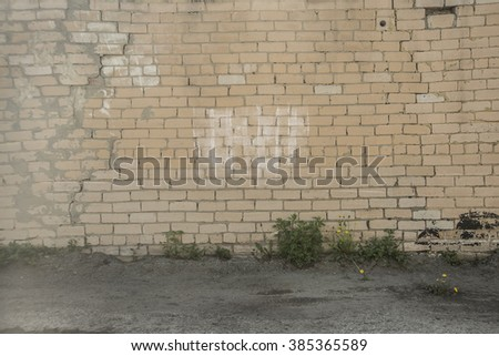 Grunge white brick stone wall with land floor background