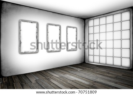 Grunge white room with old frames on a wall - stock photo
