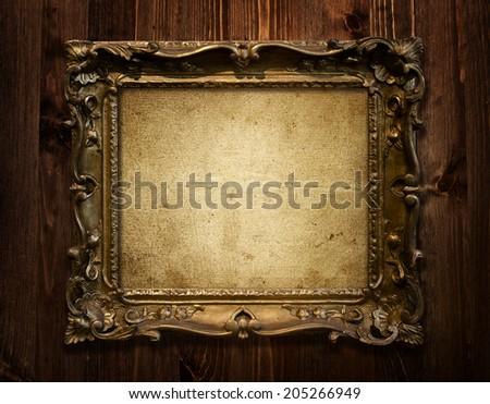 grunge wood background with golden vintage frame - stock photo