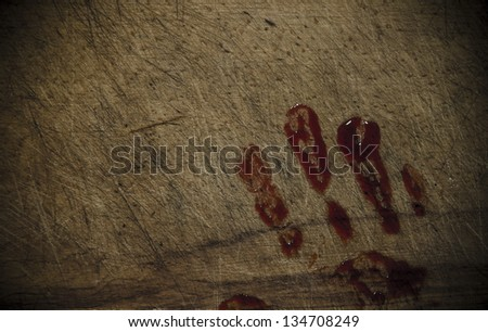 Grunge wooden background with a print of a bloody hand - stock photo