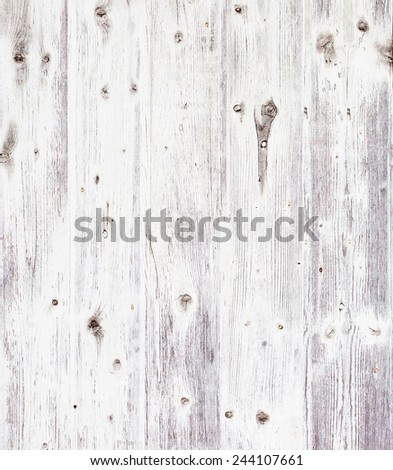 Grunge wooden board painted white. - stock photo
