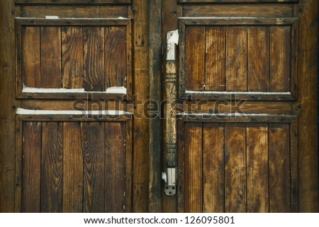 grunge wooden fence with lock - stock photo