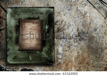 grunge wooden green picture frame on the stone wall background. - stock photo