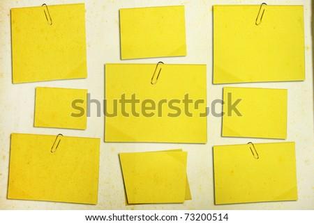 grunge yellow memo stick on background - stock photo